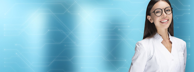 Panoramic, cover concept. A young woman doctor smiling, standing in front of a blue background with circuit board design. Communicate about health care, medical, technology