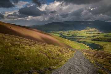 Hiking to the top of skiddaw mountain Lake District England view on Keswick valley with beautiful sunlight