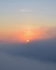 sun, sunrise with dense fog and blue sky background at dawn