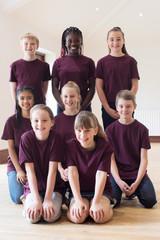 Portrait Of Children Enjoying Drama Workshop Together