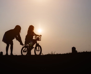 Silhouette happy family at sunset, parents, children Love affair concept Holiday hobby Family activities