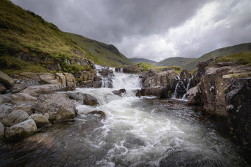Serene and wild waterfall landscape Lake District England