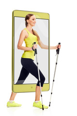 Attractive fit sporty woman enjoying nordic walking, concept virtual reality of the smartphone. going out of the device