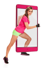 Photo of attractive young athletic running woman in sportswear, concept virtual reality of the smartphone. going out of the device