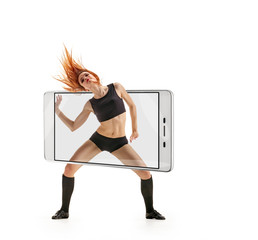 Modern flexible woman dancing contemporary on white background, concept virtual reality of the smartphone. going out of the device