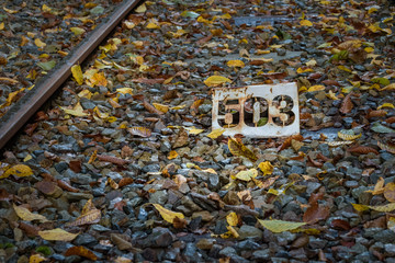 Close up railway with yellow, brown and red colored leafs