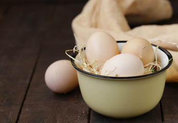 natural organic eggs on a wooden table