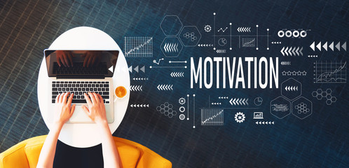 Motivation with person using a laptop on a white table