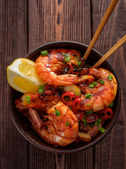 Fried Prawns with pepper, garlic and lemon. Mediterranean cuisine. Asian cuisine. Top view