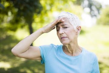 Senior woman has headache