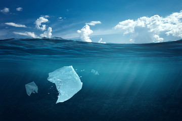 Creative background, plastic bag floating in the ocean, a bag in the water. The concept of environmental pollution, non-decomposable plastic, increased debris in the world's oceans. copy space