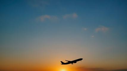 Plane taking off sky sunset sun dusk in airport