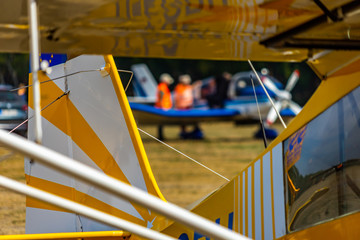 Abstract looking picture of the rear part of a yellow and white striped antique small plane.