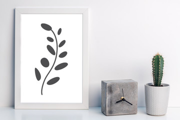 White desk with a cactus, concrete clock and plant graphics