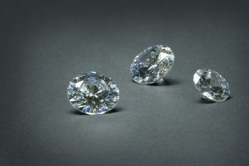Diamonds-like cubic zirconias on a dark background.