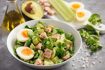 Healthy tuna salad with avocado and eggs.