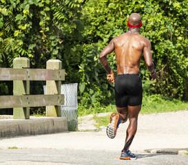 African American runner racing 10K in a park