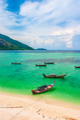 Emerald green clear glass and boat for tourist service, Southern Thailand