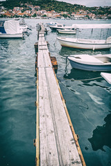 Wooden pier with boats in harbor, Trogir, Croatia