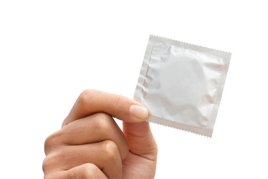 Man's hand holding condom isolated on a white background - clipping paths