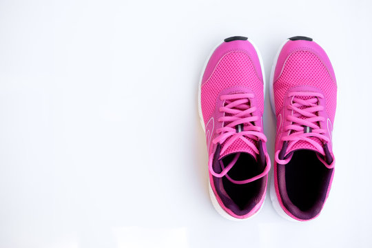 pink running shoes for women on a white background