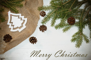 christmas background, spruce branches, fir cones, fir-tree, on a white wooden background