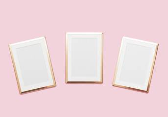 Golden frame mock up on pastel pink background.