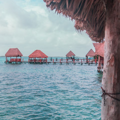 Tropical huts on Bacalar's lake and blue sky