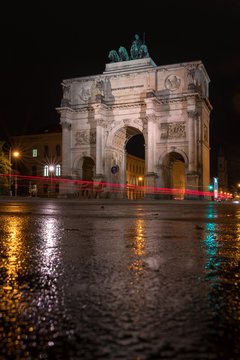 The Siegestor Victory Arch in Munich. Triumphal arch at night on a rainy day. Side view.