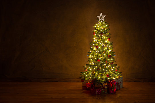 decorated christmas tree with many colorful gifts