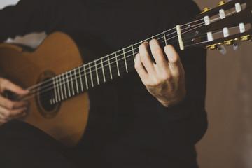 Closeup hands playing classical guitar