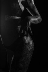 Monochrome bodyscapes of a fit tattooed woman