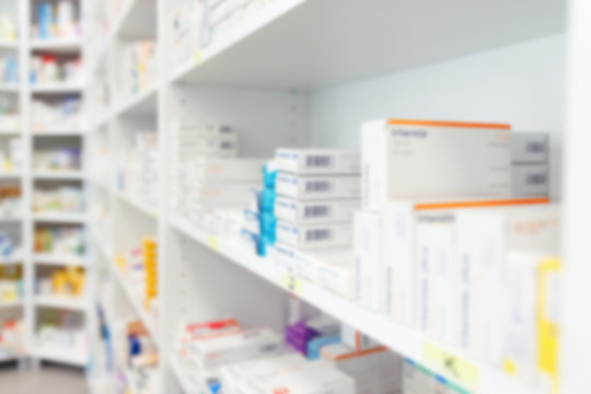 Blurred medicine and healthcare product on shelves at pharmacy drugstore
