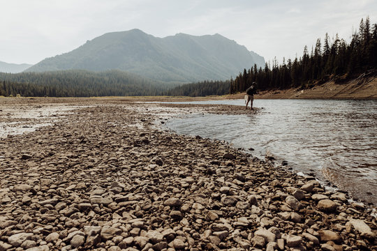 Scenic View of Fly Fisherman in Low Water of Hyalite Reservoir in Montana