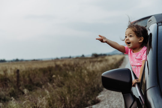 Little Girl on Road Trip Full of Wonder and Exploration