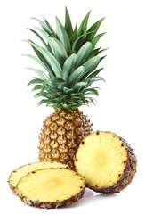 Fresh whole and sliced pineapple