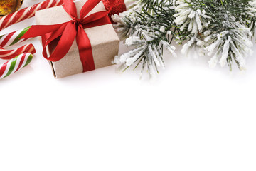 Christmas background on a white background with gift, candy and spruce branch