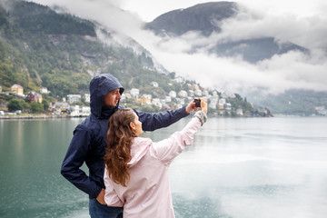 Friends take pictures of Selfie on the background of Odda, Norway