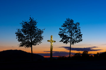 two trees and a crucifix