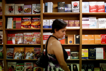 People visit the bookstore on board of the MV Logos Hope, which is the largest floating bookfair at the Acajutla port