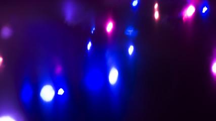 Festive dark background bokeh, light effect, neon light.
