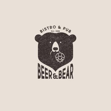 Beer and bear pub logo. The head of bear and letters emblem. Craft beer emblem. Bear keeps hop cones.