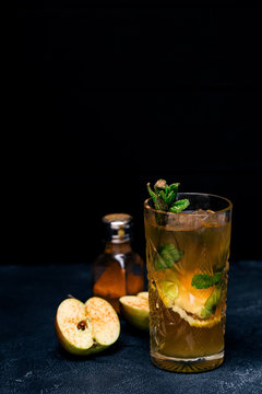 Cocktail with cinnamon and apple