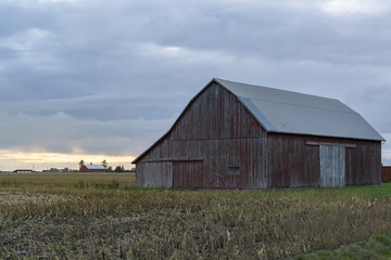 An Old Red Barn and a Field