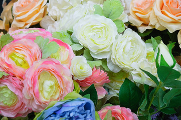 Flower composition. Peonies and roses. Close-up.