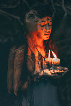 woman holding candle in hands close up