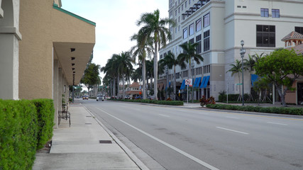 Downtown east Boca Raton Florida day time exterior establishing shot photo of street view traffic passing businesses stores and hotels