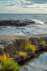 Rocky Shoreline of Lake Superior with Waves and Fall Color
