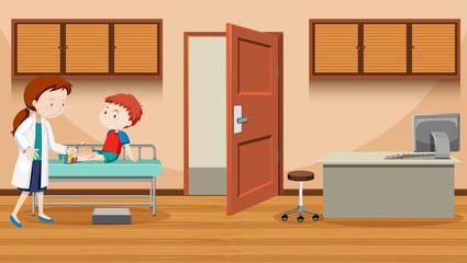 Doctor helping injured boy