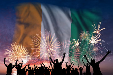 People are looking on fireworks and flag of Cote d'Ivoire